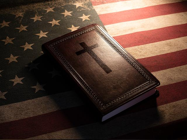 A Bible on top of an American flag
