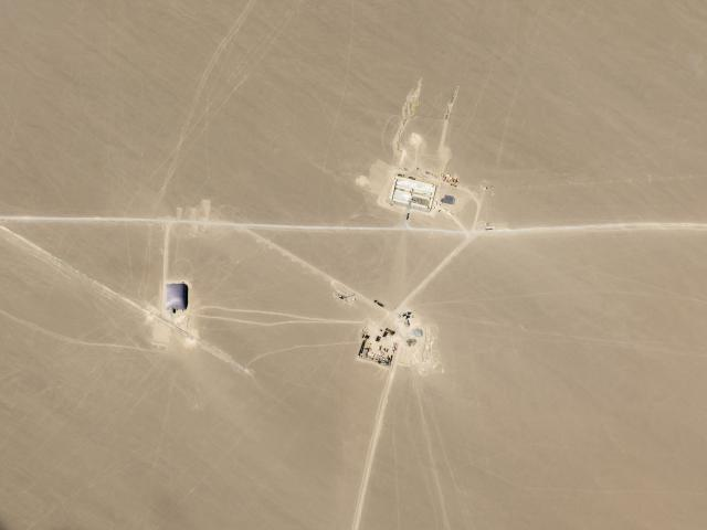 This July 25, 2021, satellite image provided by Planet Labs Inc. shows what analysts believe is construction on an intercontinental ballistic missile silo near Hami, China. (Planet Labs Inc. via AP)