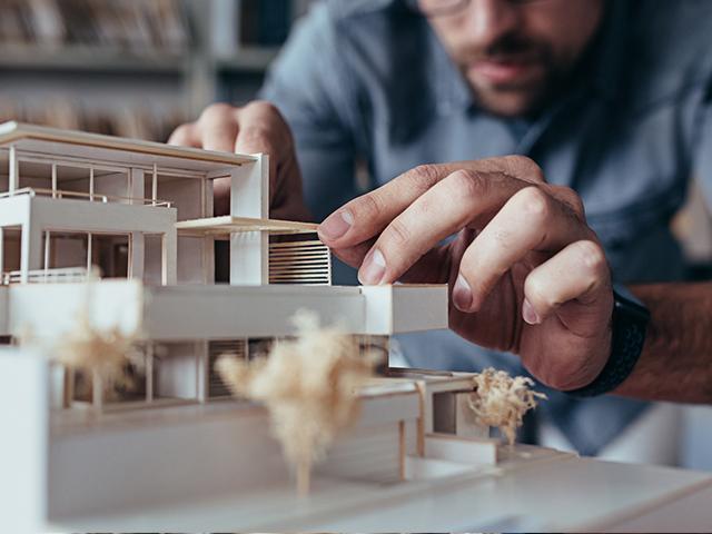 architect building a model house