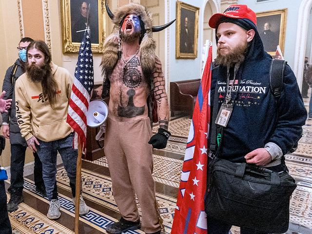 Rioters confronted by Capitol Police officers outside the Senate Chamber inside the Capitol, Wednesday, Jan. 6, 2021. (AP Photo/Manuel Balce Ceneta)