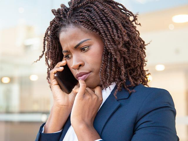 concerned woman on the phone