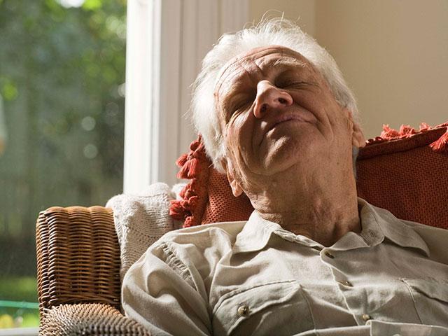 elderly man napping
