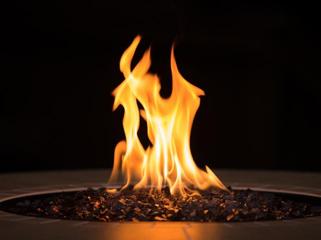 flame burning in a fire pit