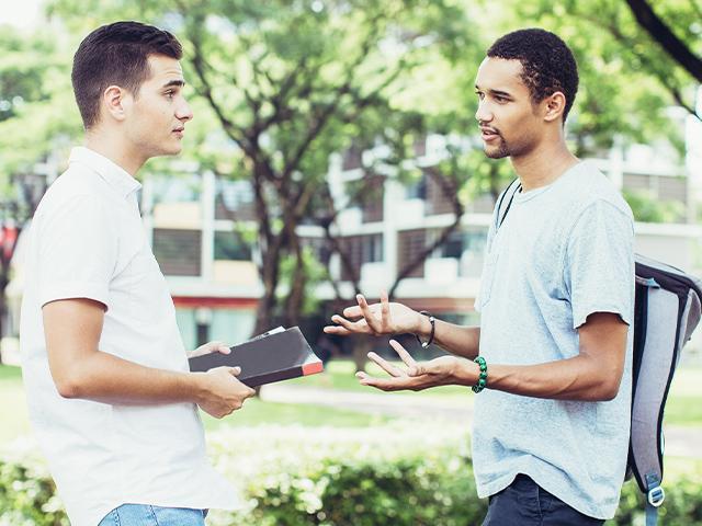 two friends talking outside