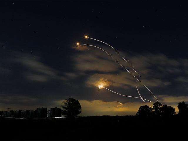 Israeli Iron Dome air defense system launches to intercept rockets fired from Gaza Strip, near Sderot, Israel, Thursday, May 13, 2021. (AP Photo/Ariel Schalit)
