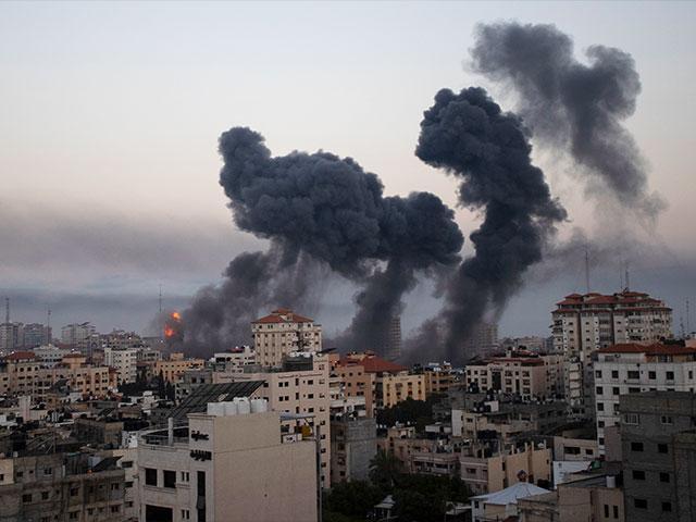 Smoke rises after Israeli airstrikes on Gaza City, Wednesday, May 12, 2021. (AP Photo/Khalil Hamra)