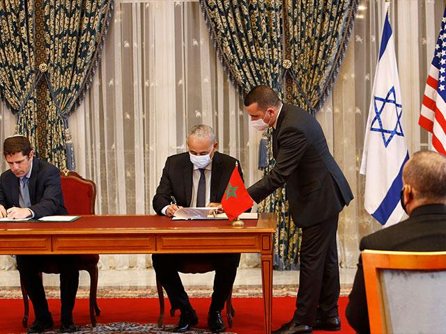 In this Dec. 22, 2020 file photo, Morocco and Israel sign normalization agreements. (AP Photo/Abdeljalil Bounhar, File)