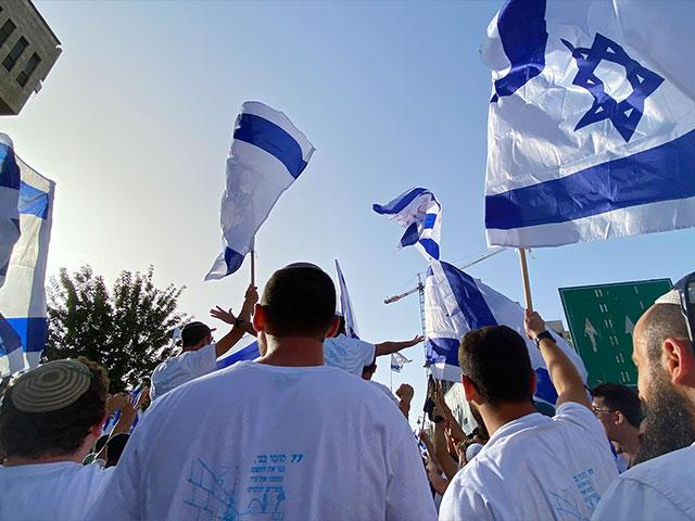 Israelis sitting down after Red Alert siren on Jerusalem Day. Photo Credit: CBN News