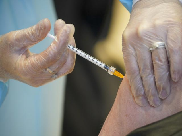 In this Wednesday, March 10, 2021 file photo, a health worker administers a dose of the AstraZeneca vaccine against COVID-19. (AP Photo/Andrew Medichini, file)