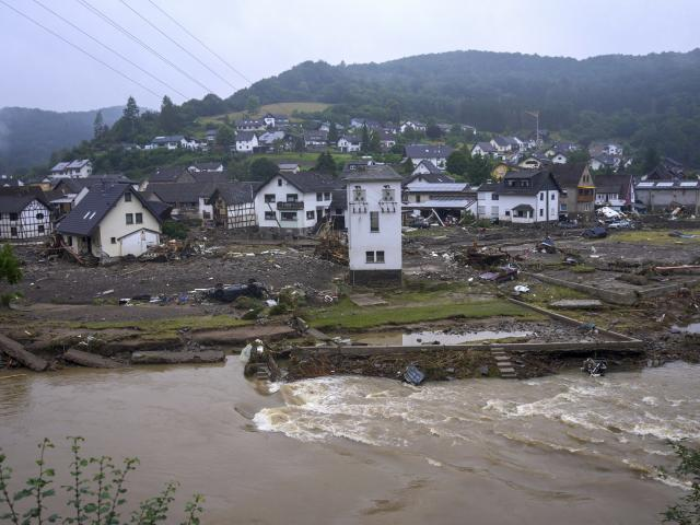 The river Ahr passes the village of Schuld, Germany, Friday, July 16, 2021 the day after the flood disaster. (Thomas Frey/dpa via AP)