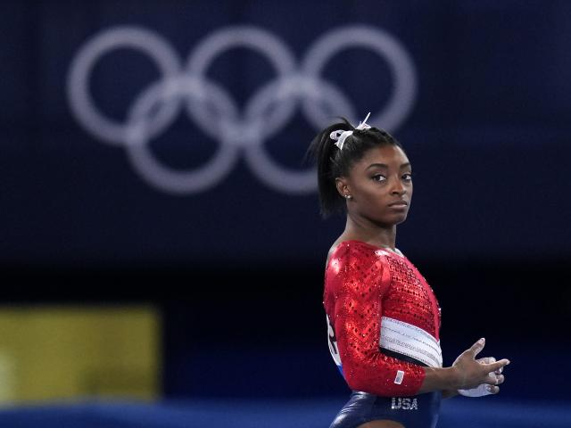 Simone Biles, of the United States, waits to perform on the vault during the artistic gymnastics women