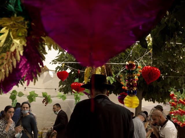 People shop for items to be used in rituals of the Jewish Sukkot holiday in Jerusalem, Monday, Sept. 20, 2021. (AP Photo/Maya Alleruzzo)