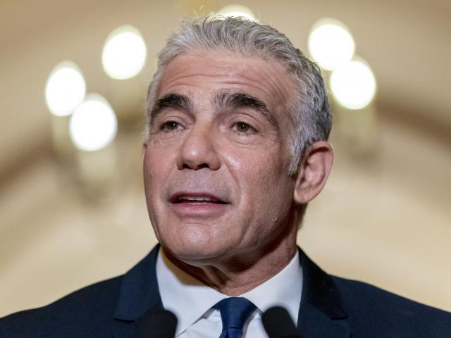 Israel Foreign Minister Yair Lapid speaks as he meets with House Speaker Nancy Pelosi of Calif., on Capitol Hill in Washington, Tuesday, Oct. 12, 2021. (AP Photo/Andrew Harnik)