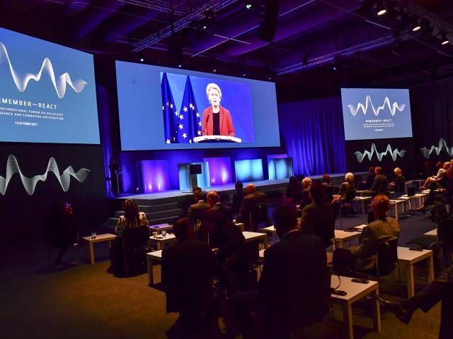 European Commission President Ursula von der Leyen speaks via video link during the Malmo International Forum on Holocaust Remembrance and Combating Antisemitism in Malmo, Sweden, Wednesday, Oct. 13, 2021. (Jonas Ekstromer/TT News Agency via AP)