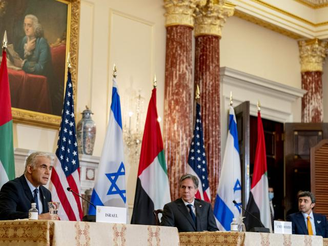 Israeli Foreign Minister Yair Lapid, left, accompanied by Secretary of State Antony Blinken, right, speaks at a joint news conference at the State Department in Washington, Wednesday, Oct. 13, 2021. (AP Photo/Andrew Harnik, Pool)