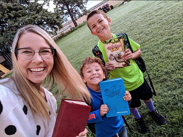 Whitney, Sterling, and Stedson bringing Bibles to school in Idalou, TX.