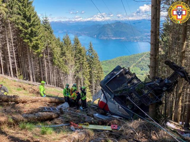 Rescuers at the wreckage of a cable car after it collapsed near the summit of the Stresa-Mottarone line in the Piedmont region, northern Italy. (Soccorso Alpino e Speleologico Piemontese via AP)