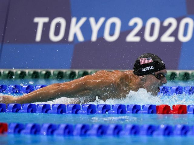 Caeleb Dressel, of United States, swims in the men's 4x100-meter medley relay final at the 2020 Summer Olympics, Sunday, Aug. 1, 2021, in Tokyo, Japan. (AP Photo/David Goldman)