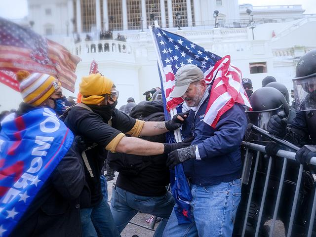 Trump supporters try to break through a police barrier, Wednesday, Jan. 6, 2021, atTrump supporters try to break through a police barrier, Wednesday, Jan. 6, 2021, at the Capitol in Washington. the Capitol in Washington.