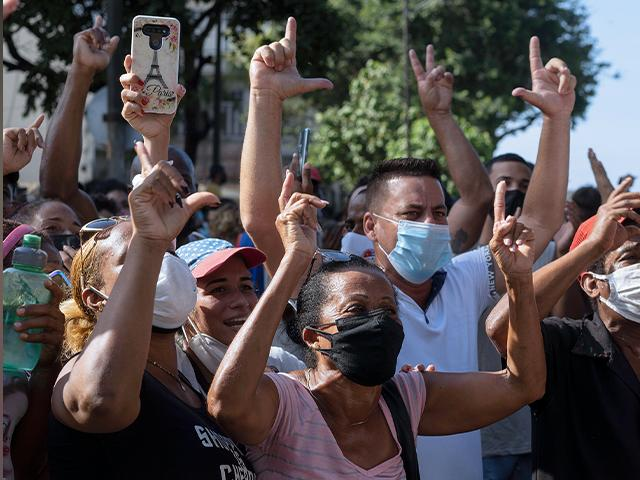 Protesters march in Havana, Cuba, July 11, 2021. Hundreds of demonstrators took to the streets in several cities in Cuba to protest against ongoing food shortages and high prices of foodstuffs. (AP Photo/Eliana Aponte)