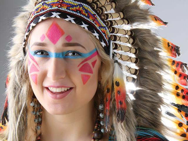 woman with face paint and feather headdress