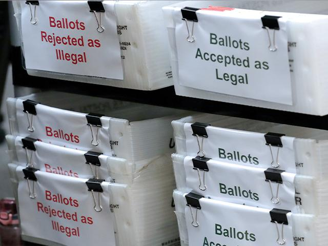 Boxes for illegal and legal vote-by-mail ballots as the Miami-Dade County canvassing board meets to verify signatures on vote-by-mail ballots for August 18 primary election on July 30 (AP Photo/Lynne Sladky)