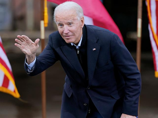 President-elect Joe Biden waves to supporters after speaking at a drive-in rally for Georgia Democratic candidates for U.S. Senate Raphael Warnock and Jon Ossoff, Dec. 15, 2020, in Atlanta. (AP Photo/Patrick Semansky)