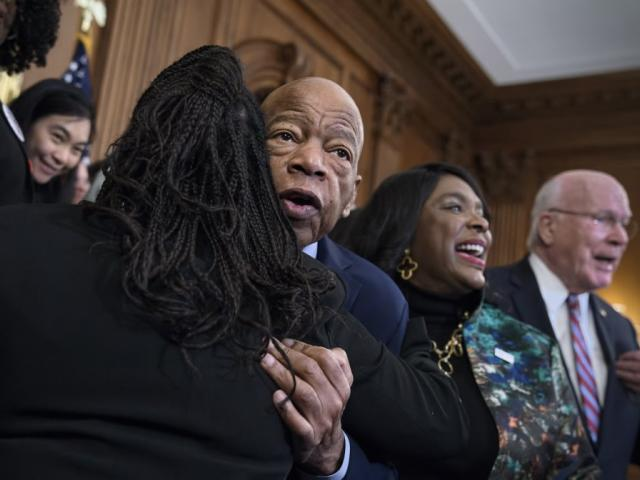 Civil rights leader Rep. John Lewis, D-Ga., is hugged as House Democrats gathered before passing the Voting Rights Advancement Act on Friday, Dec. 6, 2019. (AP Photo)