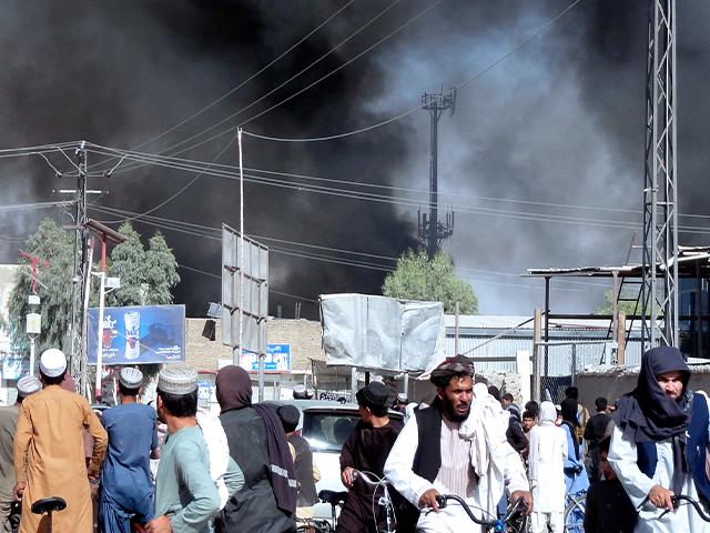 Smoke rises after fighting between the Taliban and Afghan security personnel in the city of Kandahar, southwest of Kabul, Afghanistan, Thursday, Aug. 12, 2021. (AP Photo/Sidiqullah Khan)