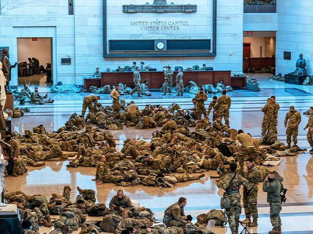 Hundreds of National Guard troops hold inside the Capitol Visitor's Center to reinforce security at the Capitol in Washington, Wednesday, Jan. 13, 2021.