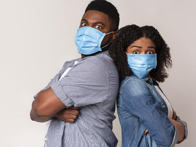 Frustrated couple wearing masks in quarantine
