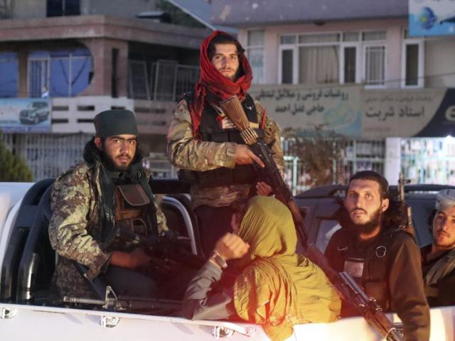 Taliban fighters patrol in Kabul, Afghanistan, Saturday, Aug. 28, 2021. (AP Photo/Khwaja Tawfiq Sediqi)