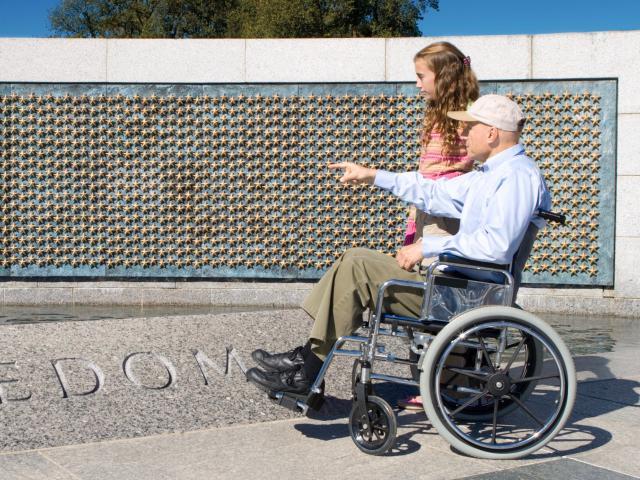 Veteran and child at memorial