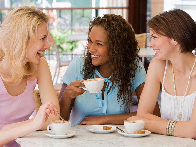women-friends-talking-cafe