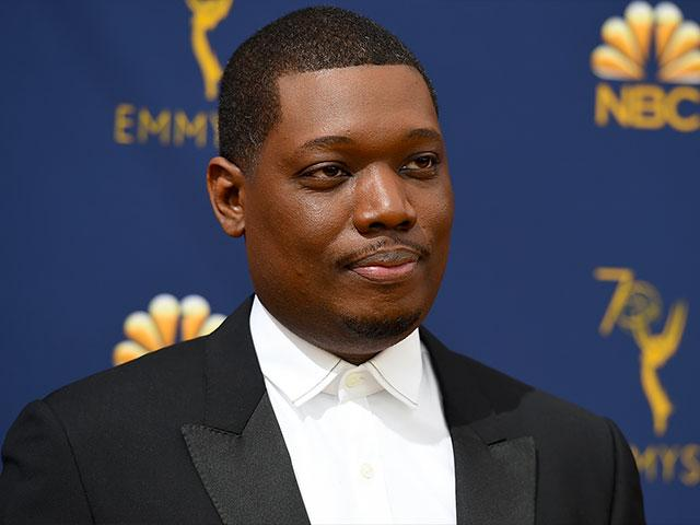 Michael Che arrives at the 70th Primetime Emmy Awards on Monday, Sept. 17, 2018, at the Microsoft Theater in Los Angeles. (Photo by Jordan Strauss/Invision/AP)