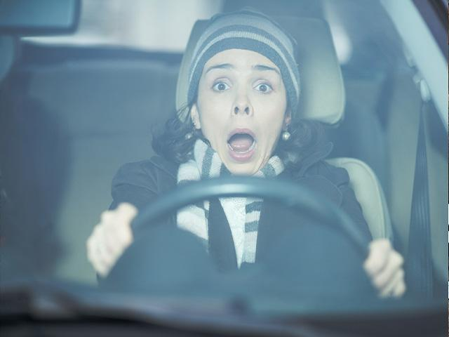 woman driving and having a near accident