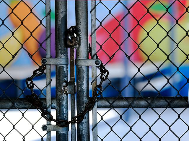 A chain-link fence lock is seen on a gate at a closed Ranchito Elementary School in the San Fernando Valley section of Los Angeles on July 13, 2020 (AP Photo/Richard Vogel)