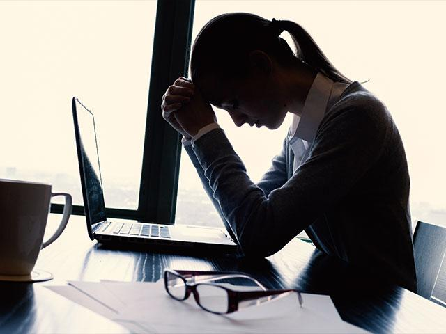 Stressed Woman on Computer