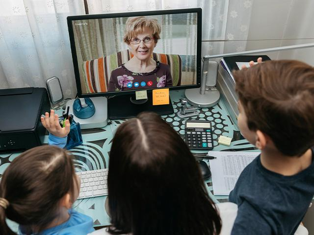 young family in a video chat with grandmother
