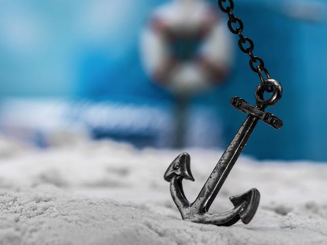 an anchor on a beach