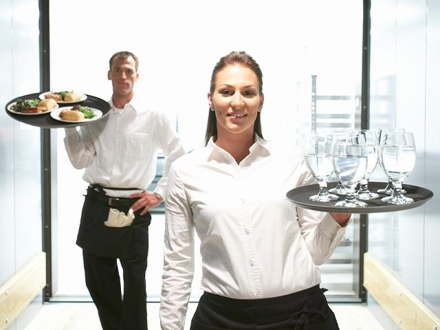 waitress and waiter carrying food and drinks