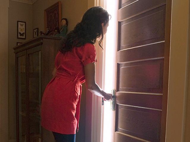 woman-opens-door_SI.jpg