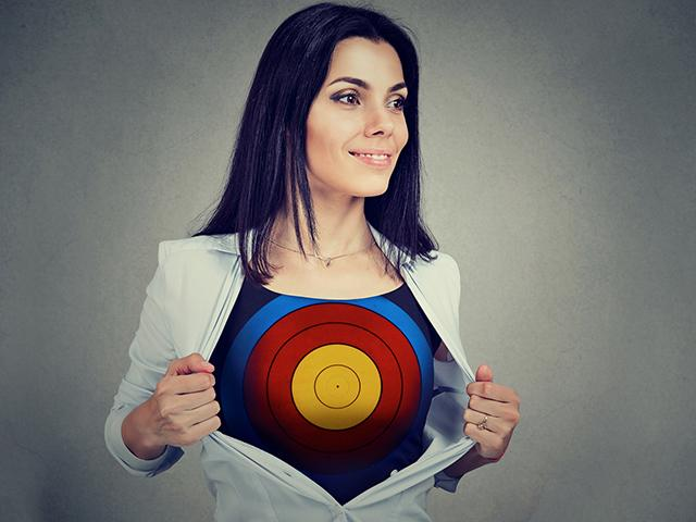 woman with bulls eye target on her chest