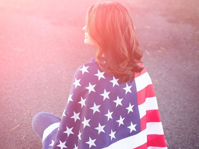Woman wrapped in an American flag