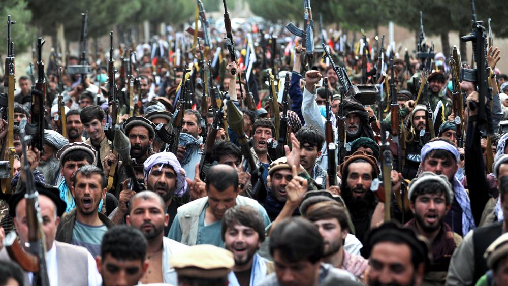 Afghan militiamen join Afghan defense and security forces during a gathering in Kabul, Afghanistan, June 23, 2021, as Pentagon wraps up U.S. military withdrawal. (AP Photo/Rahmat Gul)