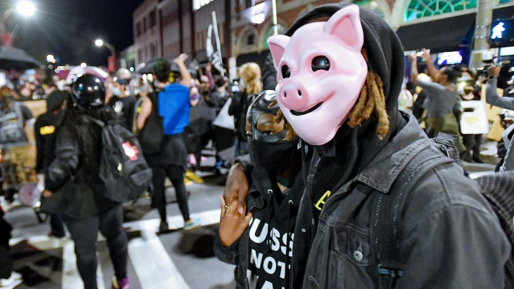 Demonstrators march through the streets in Rochester, N.Y., Friday, Sept. 4, 2020 protesting the death of Daniel Prude.
