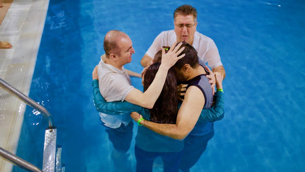Muslim-background believers being baptized somewhere in the Middle East.