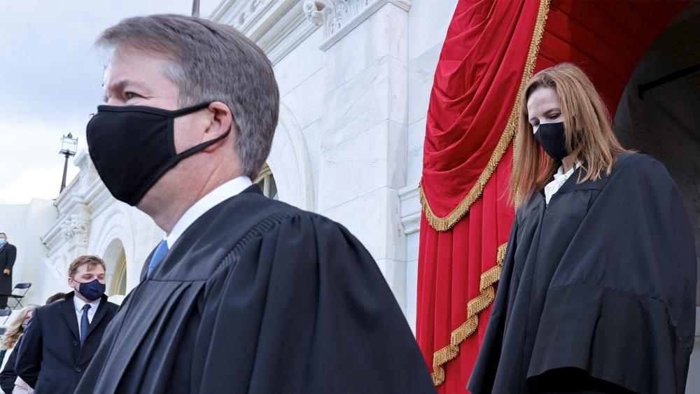 Supreme Court Justices Brett Kavanaugh and Amy Coney Barrett arrive for the 59th Presidential Inauguration, Jan. 20, 2021. (Jonathan Ernst/Pool Photo via AP)