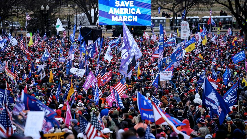 Trump supporters gather on the Washington Monument grounds in advance of a rally Wednesday, Jan. 6, 2021, in Washington. (AP Photo/John Minchillo)