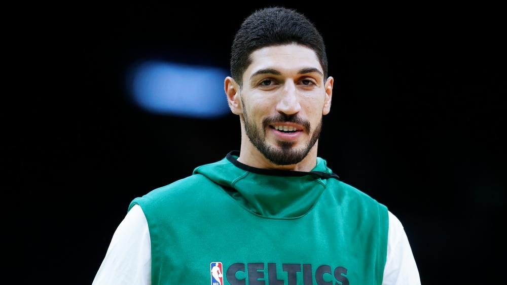 Boston Celtics' Enes Kanter warms up before a preseason NBA basketball game against the Charlotte Hornets in Boston, Sunday, Oct. 6, 2019. (AP Photo/Michael Dwyer)